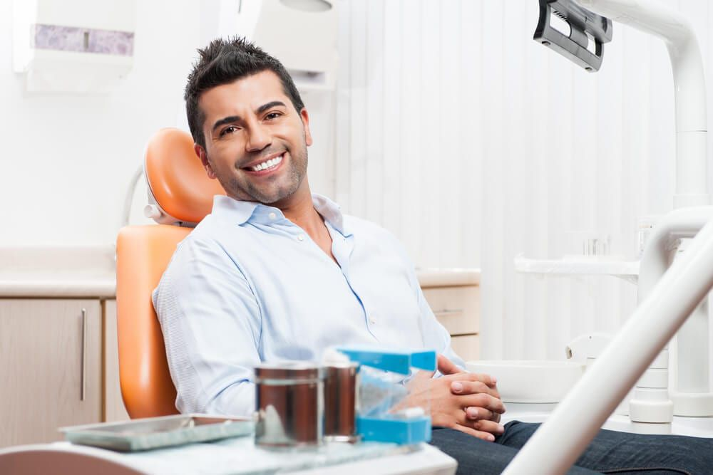 happy dental patient waiting for cleaning