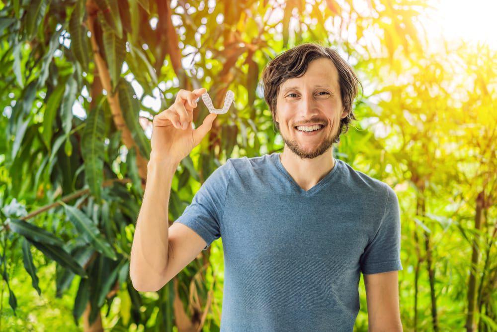 male holding bracket for invisalign