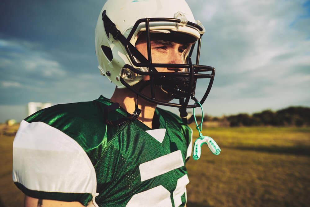 football player in the field with mouth guard