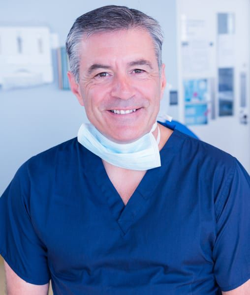 male dentist in his 50s sitting on dental chair