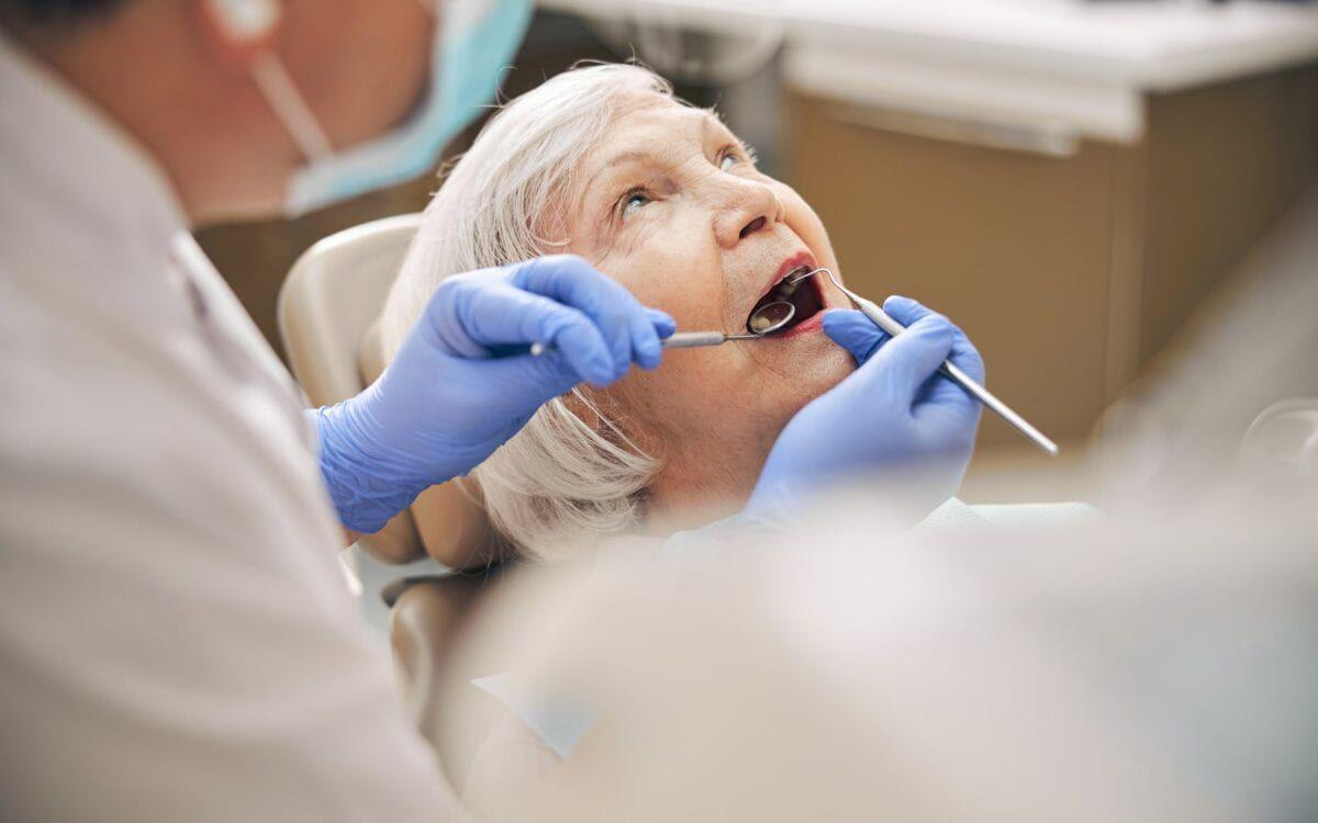 Elderly Woman In Dental Chair